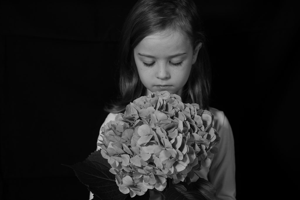 girl holding flowers black and white