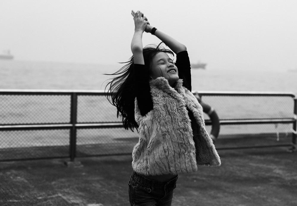 girl-jumping-eyes-closed